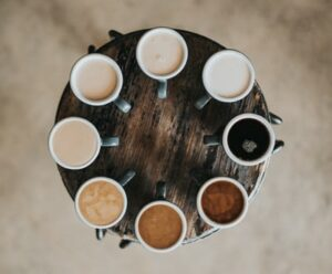 eight cups of coffee in a circle on a table