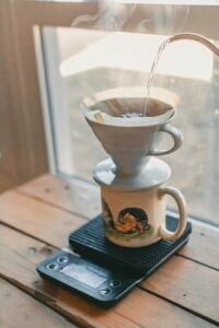 pour over coffee on coffee mug on scale by window
