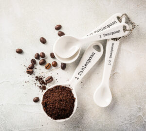 measuring spoons filled with coffee grounds