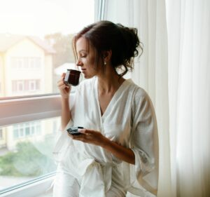 woman drinking espresso at home