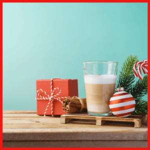 sugar cookie latte, Christmas ornament red & white stripe with present in red wrapping paper, festive on wooden table