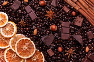 full picture of roasted coffee beans, chocolate, various nuts, starfruit and grapefruit