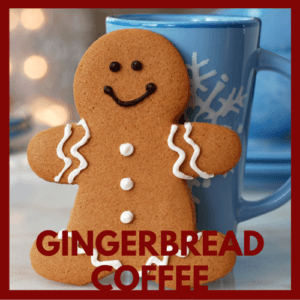 gingerbread man cookie, standing against a light blue snowflake decorated coffee mug, out of focus christmas lights in background